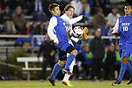 25 October 2013: Duke's Rob Dolot (24) is challenged by Wake Forest's Luca Gimenez (BRA) (in white) as Duke's Luis Rendon (10) watches. The Duke University Blue Devils hosted the Wake Forest University Demon Deacons at Koskinen Stadium in Durham, NC in a 2013 NCAA Division I Men's Soccer match. The game ended in a 2-2 tie after two overtimes.