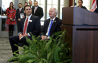 NWA Democrat-Gazette/DAVID GOTTSCHALK   Joe Rollins (left), principal at the Don Tyson School of Innovation, and Governor Asa Hutchinson, listen Thursday, February 9, 2017, during a dedication ceremony for Springdale's new Don Tyson School of Innovation campus. The school is named after Donald Tyson former chairman and chief executive officer of Tyson Foods. Half of the campus opened in August, with construction wrapping up on the other half in time for this semester.
