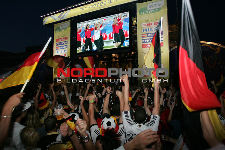 FIFA WM 2006 - Feature Fanmeile Berlin<br /> Play #63 (08-Jul) - Germany vs Portugal.<br /> Supporters from Germany celebrate the 3-1 victory against Portugal at Brandenburger Tor in Berlin after the match of the World Cup in Stuttgart. J&cedil;rgen Klinsmann is on the screen.<br /> Foto &copy; nordphoto