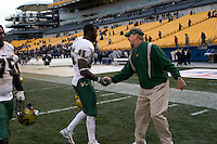 Head Coach Jim Leavitt congratulates George Selvie (95) after the South Florida Bulls defeated the Pitt Panthers 48-37 on November 24, 2007 at Heinz Field, Pittsburgh, Pennsylvania.