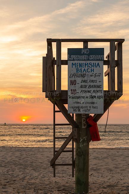 The sun sets over the Atlantic Ocean as viewed from Menemsha Beach in Chilmark, Massachusetts on Martha's Vineyard.
