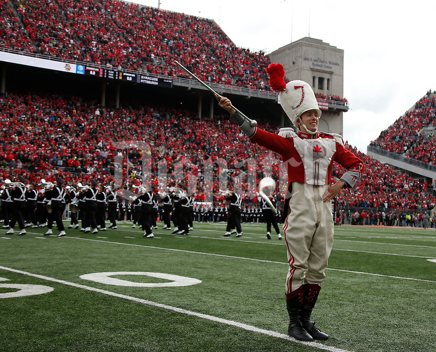 Head drum major John LaVange take the field with the Ohio State University marching band for the pre-game show before Saturday's NCAA Division I football game at Ohio Stadium in Columbus on November 26, 2016. (Barbara J. Perenic/The Columbus Dispatch)