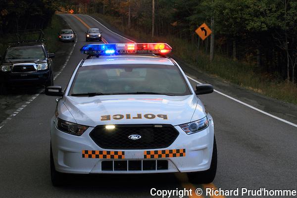 A Quebec Provincial police car blocking a road