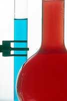 LABGLASS: TEST TUBE and VOLUMETRIC FLASK<br /> Blue test tube and red flask on white background
