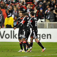 D.C. United midfielder Nick DeLeon (18) celebrates with teammates after New York Red Bulls defender Roy Miller score and owngoal. The New York Red Bulls tied D.C. United 1-1 in the first leg of the Eastern Conference semifinals at RFK Stadium, Saturday November 3, 2012.