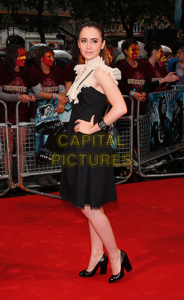 "LILY COLLINS .The World Premiere of ""Harry Potter and the Half-Blood Prince"" at the Odeon cinema, Leicester Square, London, England. .July 7th 2009. .Half Blood full length hand on hip black cream white pleated pleats collar pleats patent shoes dress.CAP/ROS.©Steve Ross/Capital Pictures."