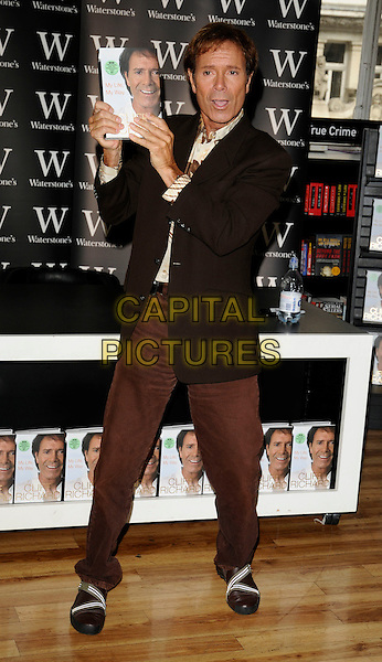 "SIR CLIFF RICHARD.at a signing of his new autobiography ""My Life, My Way"" at Waterstone's Book Shop, Piccadilly, London, England,.September 6th 2008..full length black jacket brown trousers print shirt shoes  .CAP/CAN.©Can Nguyen/Capital Pictures"