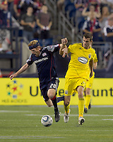 New England Revolution midfielder Pat Phelan (28) and Columbus Crew defender Eric Brunner (23) collide. The New England Revolution tied Columbus Crew, 2-2, at Gillette Stadium on September 25, 2010.