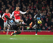 13.12.2014.  London, England. Premier League. Arsenal versus Newcastle. Newcastle United's Cheik Ismael Tioté' challenges Arsenal's Kieran Gibbs.