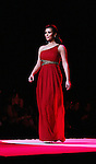 Kim Kardashian walks the runway of The Heart Truth's Red Dress Collection on February 11, 2010 at Mercedes-Benz Fashion Week - Fall 2010 Collections at Bryant Park, NYC. (Photo by Sue Coflin/Max Photos)