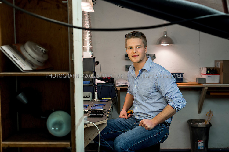 1/29/2014&mdash;Bellingham, WA, USA<br /> <br /> Mark King, 24, in his office and work space in Bellingham, WASH. north of Seattle. In this small work space,  King and his one employee assemble his Trayvax wallet (seen on table), a digital-theft-proof wallet King designed and funded through a Kickstarter campaign.<br /> <br /> Photograph by Stuart Isett<br /> &copy;2014 Stuart Isett. All rights reserved.