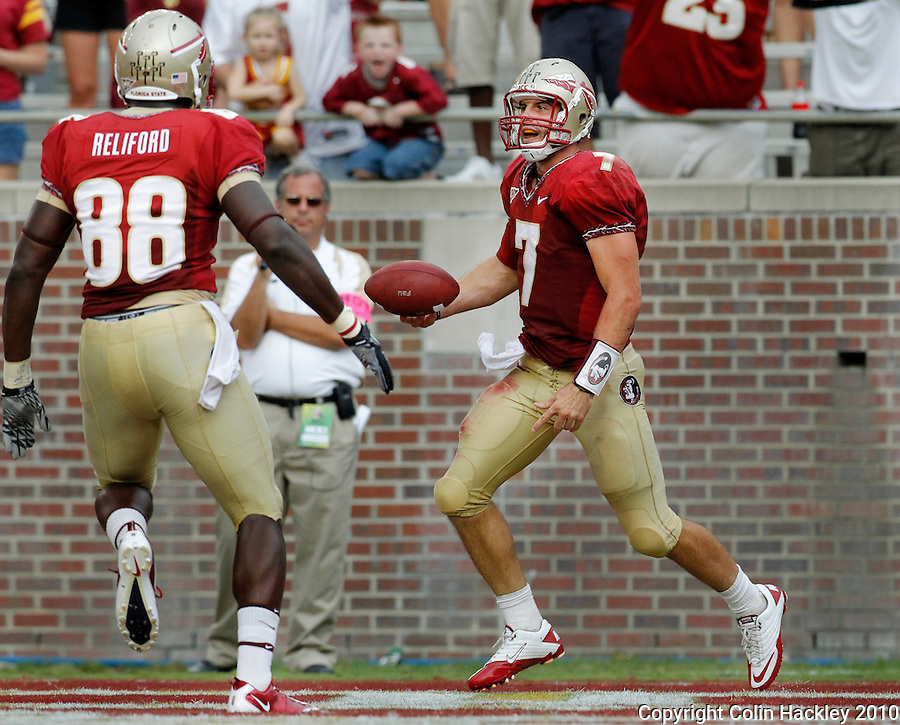 TALLAHASSEE, FL 9/25/10-FSU-WF FB10 CH-Florida State's Christian Ponder, right, celebrates his touchdown against Wake Forest with Beau Reliford during second half action Saturday at Doak Campbell Stadium in Tallahassee. The Seminoles beat the Demon Deacons 31-0..COLIN HACKLEY PHOTO