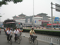 Commuters pass the famous Hong Qiao Pearl Market