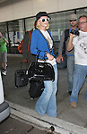 8-9-08.Paris Hilton arriving at the L.A.X airport from Europe after promoting her new line of handbags. The bags she is holding are from her line. ..AbilityFilms@yahoo.com.805-427-3519.www.AbilityFilms.com.
