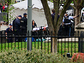 An unidentified person is attended to by United States Secret Service and US Park Police during an incident in Lafayette Park, across Pennsylvania Avenue from the White House in Washington, DC on April 12, 2019.<br /> Credit: Ron Sachs / CNP