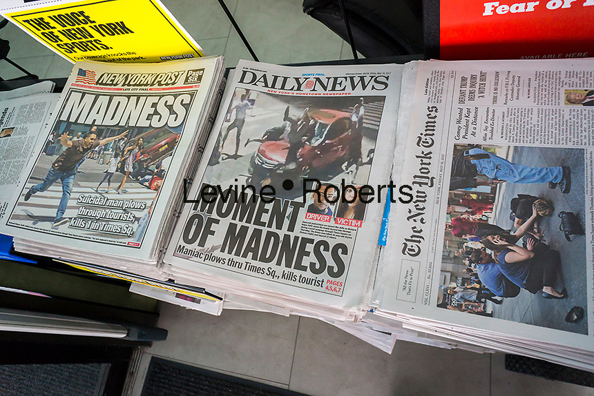 New York newspapers on Friday, May 19, 2017 report on the previous days' rampage allegedly by Richard Rojas in Times Square which killed one person and injured 22 by driving a Honda Accord in the crowds. (© Richard B. Levine)