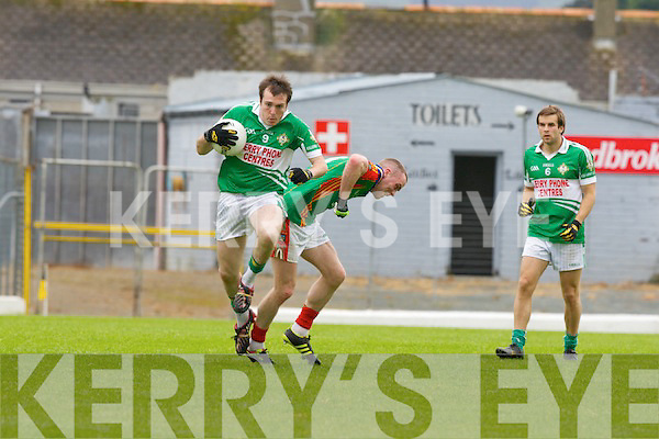 Gary Sayers Mid Kerry is flattened by Kevin Breen Legion during their County Championship clash in Fitzgerald Stadium on Sunday
