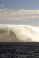 fog rolling down shoreline