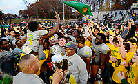 Woodbridge quarterback Antevious Jackson (3), his teammates, and fans celebrate Woodbridge's region championship after defeated Hylton 28-14 for the 6A region championship 11-25-17 in Woodbridge, VA.