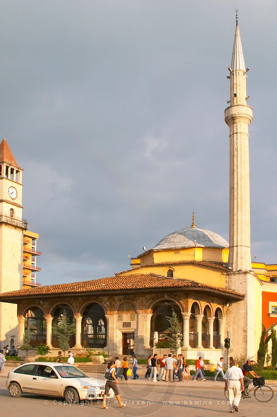 The Ethem Bey Beu Mosque. People and cars on the street in front. The Tirana Main Central Square, Skanderbeg Skanderburg Square. Tirana capital. Albania, Balkan, Europe.