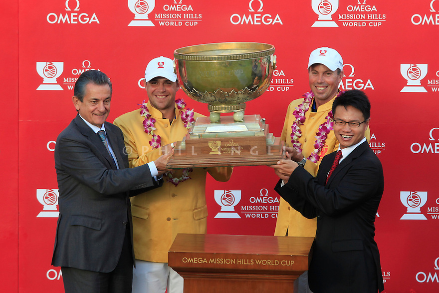 Gary Woodland and Matt Kuchar of USA presented with their World Cup jackets during the prizegiving of the Omega Mission Hills World Cup played at The Blackstone Course, Mission Hills Golf Club on November 27th in Haikou, Hainan Island, China.( Picture Credit / Phil Inglis )