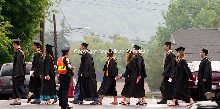 WINSTED, CT- 31 MAY 2007- 053107JT06- <br /> <br /> Northwestern Connecticut Community College graduates cross the street from the college to East End Park at the start of commencement ceremonies on Thursday in Winsted.<br /> Josalee Thrift Republican-American