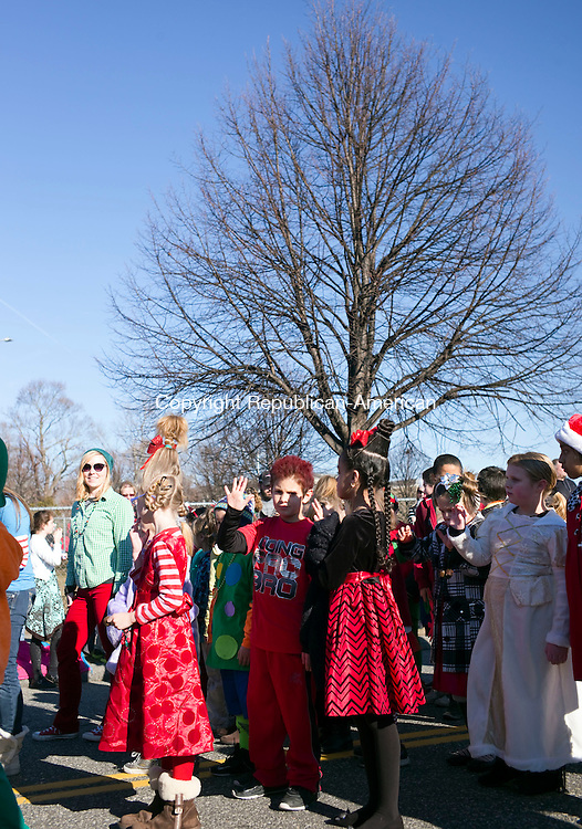 Torrington, CT- 06 December 2015-120615CM06-  Children from Vogel-Wetmore School, dressed in holiday costumes, march in the annual Torrington Christmas parade on Sunday. The event kicked off the opening of town's 68th year of the Christmas Village.   Christopher Massa Republican-American