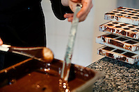 Chocolatier Patrice Arbona at work making chocolate in his shop 'Entre Mes Chocolats', Vence, France, 10 February 2011