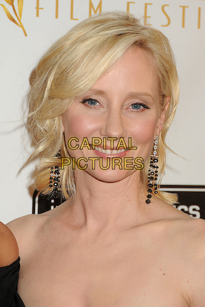 Anne Heche.12th Annual Beverly Hills Film Festival Opening Night held at the AMPAS Samuel Goldwyn Theater, Beverly Hills, California, USA..April 25th, 2012.headshot portrait dangling earrings black  .CAP/ADM/BP.©Byron Purvis/AdMedia/Capital Pictures.
