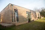 Oak panelling walls of modern newly built sustainable house at Snape, Suffolk, England