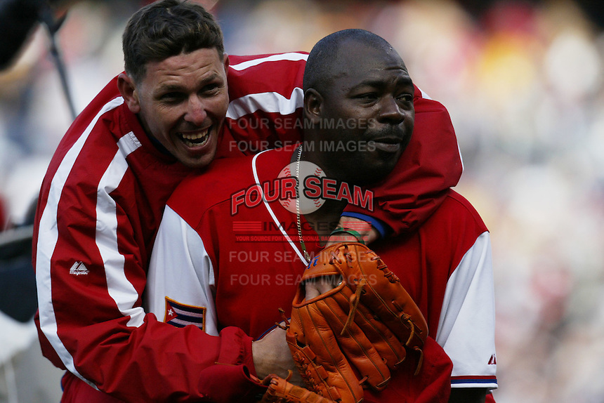 Yunieski Maya and Pedro Luis Lazo of the Cuban national team celebrate win against the Dominican Republic team during the World Baseball Championships at Petco Park in San Diego,California on March 18, 2006. Photo by Larry Goren/Four Seam Images