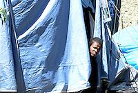 Roma, 7 Giugno 2016<br /> Una donna nella tenda<br /> Operazioni di controllo tra i rifugiati della tendopoli sorta spontanea in Via Tiburtina e in via Cupa dove c'era il centro di accoglienza Baobab