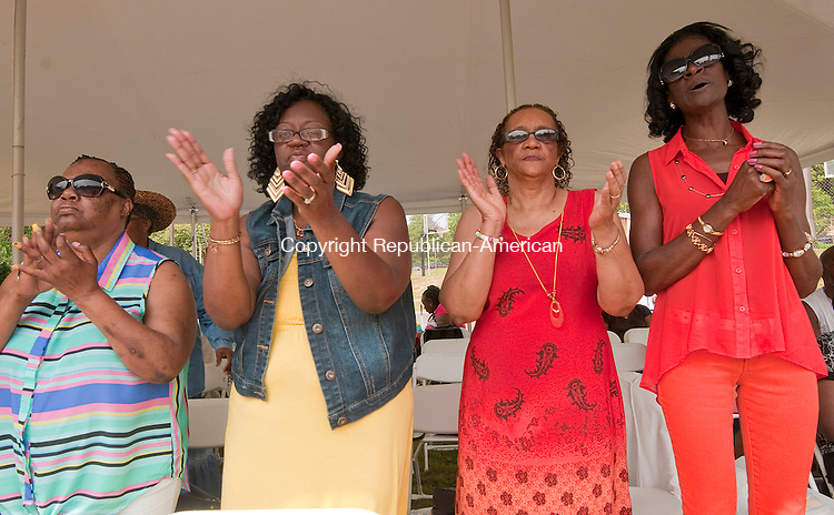 WATERBURY, CT 081614JS22--Vivian Foote of Waterbury; Cheryl Stakely of Waterbury; Vera Morgan of Sandusky, Ohio and Priscilla Washington of Waterbury stand and sing during the annual Gospel Expo Saturday at the North End Recreational Center in Waterbury. The event was hosted by the Spiritual Souls of Waterbury and the Refuge Church of Christ Missionaries. <br /> Jim Shannon Republican-American