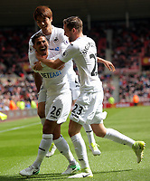 SUNDERLAND, ENGLAND - MAY 13: (L-R) Kyle Naughton of Swansea City celebrates his goal with team mates Ki Sung-Yueng and Gylfi Sigurdsson during the Premier League match between Sunderland and Swansea City at the Stadium of Light, Sunderland, England, UK. Saturday 13 May 2017