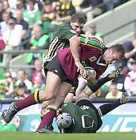 10/04/2002 - Powergen National Cup Final - Twickenham.London Irish vs Northampton..Exiles Steve Williams tackles Olivier Brouzet