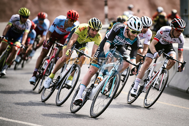 The peloton including Quentin Pacher (FRA) Vital Concept–B&B Hotels descends during Stage 4 of 10th Tour of Oman 2019, running 131km from Yiti (Al Sifah) to Oman Convention and Exhibition Centre, Oman. 19th February 2019.<br /> Picture: ASO/P. Ballet | Cyclefile<br /> All photos usage must carry mandatory copyright credit (© Cyclefile | ASO/P. Ballet)