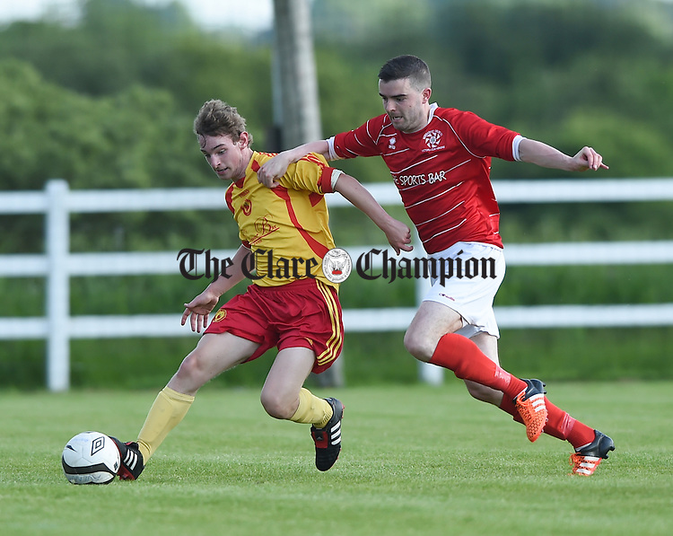 Killian O Daly of Avenue B in action against David O Grady of Newmarket Celtic A during their Soccer Cup final at the County Grounds. Photograph by John Kelly.