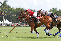 WELLINGTON, FL - MARCH 26:  Valiente's Matias Torres Zavaleta tries to take the ball from Coca Cola's Julian de Lusarreta (red jersey) as Valiente comes from behind to defeat Coca Cola 9-6 in the final of the 26 goal USPA Gold Cup, at the International Polo Club, Palm Beach on March 26, 2017 in Wellington, Florida. (Photo by Liz Lamont/Eclipse Sportswire/Getty Images)