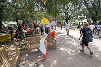Vinny Vigorita '15. Occidental College students get involved at the annual Involvement Fair (formerly Club Day) on Tuesday, September 11, 2012 in the Academic Quad. About 120 organizations set up shop with mailing list sign up sheets, fliers for upcoming events and information about ways to get involved with their department or organization. (Photo by Marc Campos, Occidental College Photographer)