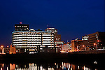 Downtown Dayton Ohio at night from North near Main Street Bridge. Showing Caresource building.