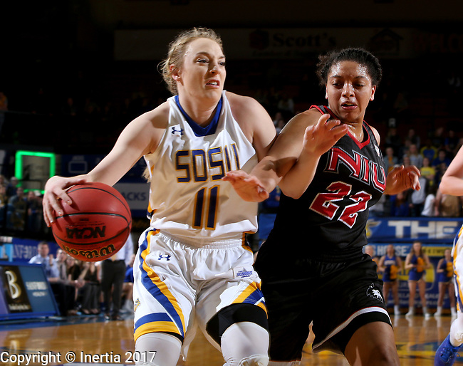 BROOKINGS, SD - MARCH 16:  Madison Guebert #11 from South Dakota State University is fouled while taking hate all to the basket by Janae Poisson #22 from Northern Illinois during their first round WNIT game Thursday at Frost Arena in Brookings.(Photo by Dave Eggen/Inertia)