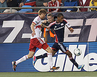 New England Revolution substitute forward Jerry Bengtson (27) dribbles down the wing as New York Red Bulls defender Markus Holgersson (5) defends. In a Major League Soccer (MLS) match, the New England Revolution (blue) tied New York Red Bulls (white), 1-1, at Gillette Stadium on May 11, 2013.