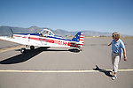 A woman pulls the tow line of the tow plane around to attach it to the glider at Gliders Minden in Minden, Nevada near Lake Tahoe.