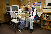 Alma Frazier, a foster granny, part of a literacy program run by Save The Children, helps a young boy improve his reading skills. The school is Jone's Fork School in Mousie, Kentucky.