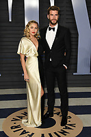 04 March 2018 - Los Angeles, California - Miley Cyrus, Liam Hemsworth. 2018 Vanity Fair Oscar Party hosted following the 90th Academy Awards held at the Wallis Annenberg Center for the Performing Arts. <br /> CAP/ADM/BT<br /> &copy;BT/ADM/Capital Pictures