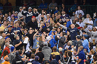 Milwaukee Brewers fans attempt to catch a foul ball during a game against the Minnesota Twins at Miller Park on May 27, 2013 in Milwaukee, Wisconsin.  Minnesota defeated Milwaukee 6-3.  (Mike Janes/Four Seam Images)