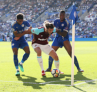 West Ham United's Andy Carroll holds off Leicester City's Wes Morgan and Demarai Gray<br /> <br /> Photographer Rob Newell/CameraSport<br /> <br /> The Premier League - Leicester City v West Ham United - Saturday 5th May 2018 - King Power Stadium - Leicester<br /> <br /> World Copyright &copy; 2018 CameraSport. All rights reserved. 43 Linden Ave. Countesthorpe. Leicester. England. LE8 5PG - Tel: +44 (0) 116 277 4147 - admin@camerasport.com - www.camerasport.com