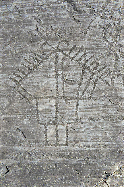 Petroglyph, rock carving, depicting houses built on poles . Carved by the ancient Camunni people in the iron age between 1000-1600 BC. Rock no 24,  Foppi di Nadro, Riserva Naturale Incisioni Rupestri di Ceto, Cimbergo e Paspardo, Capo di Ponti, Valcamonica (Val Camonica), Lombardy plain, Italy