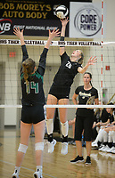 NWA Democrat-Gazette/ANDY SHUPE<br /> Bentonville's Savanna Riney (20) sends the ball over the net Tuesday, Sept. 10, 2019, as Van Buren's Brianna Ball (14) defends during play in Tiger Arena in Bentonville. Visit nwadg.com/photos to see more photos from the match.