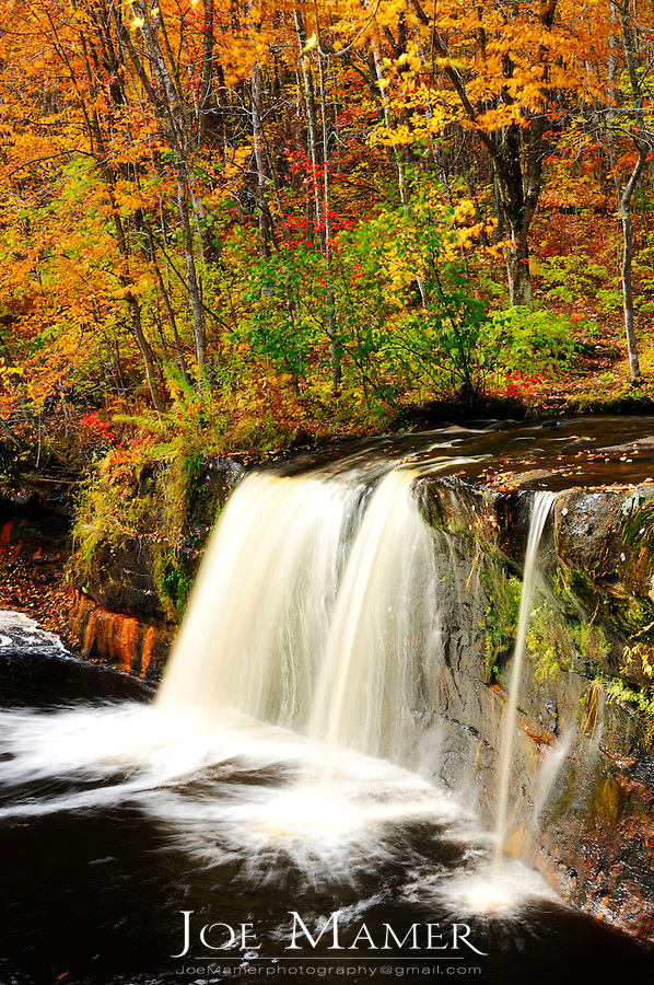 Wolf Creek Falls in Autumn color at Banning State park.